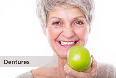 Lady with dentures holding an apple