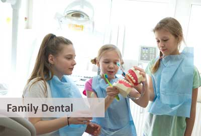girls playing with teeth mould at the dentist